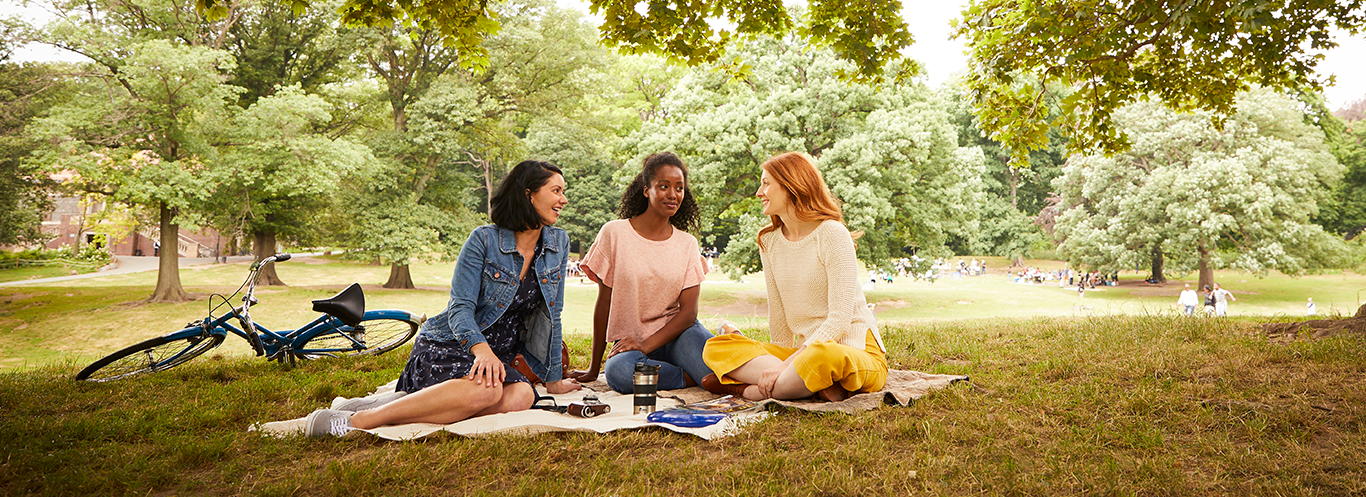 group of girls chatting in the park